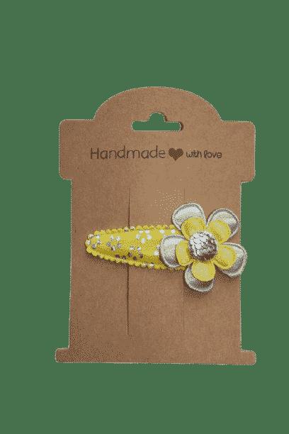 Geel haarspeldje met bloem