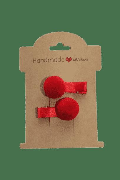 Rood pompon speldje